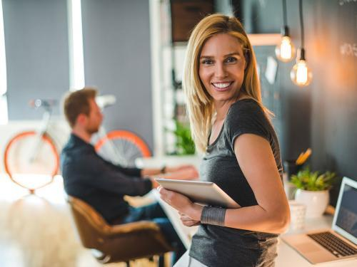 Beautiful businesswoman holding a digital tablet in a design studio.